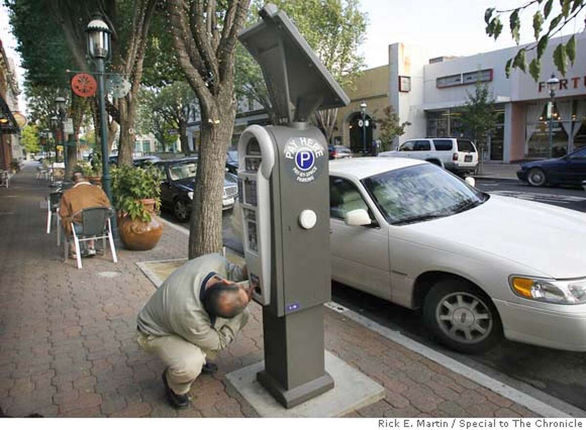 10/11/07 REDWOOD CITY, CA John Lahlouh (cq) attempts to retrieve a receipt from a central parking meter payment station on Broadway Ave. in Downtown Redwood City. Lahlouh found the task difficult as the machine seemed to be out of paper of which he needed to place on the dashboard of his car. Rick E. Martin / Special to The Chronicle MANDATORY CREDIT FOR PHOTOG AND SAN FRANCISCO CHRONICLE/NO SALES-MAGS OUT