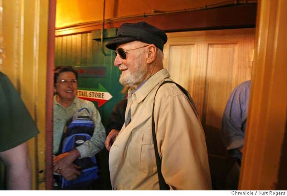 Lawrence Ferlinghetti arrives at Cafe Trieste to read some local poetry.  Poetry reading at Cafe Triest .Lawrence Ferlinghetti and others read . SATURDAY, JULY 28, 2007 KURT ROGERS SAN FRANCISCO SFC  THE CHRONICLE SFPOETREY30_0110_kr.jpg  Ran on: 07-30-2007  Poet Laureate Jack Hirschman conceived the free festival. Photo: KURT ROGERS