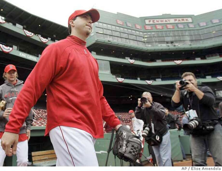 Boston Red Sox pitcher Josh Beckett strides out to the field at Fenway Park in Boston Thursday, Oct. 11, 2007 for the team workout in preparation for Friday's Game 1 of the American League Championship Series playoff baseball against the Cleveland Indians. Beckett is expected to start Game 1. (AP Photo/Elise Amendola) Photo: Elise Amendola
