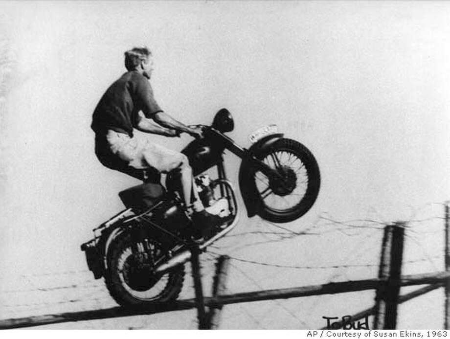 "This family photo released courtesy of Susan Ekins shows legendary stuntman Bud Ekins, doubling for Steve McQueen in the iconic motorcycle-jump scene in ""The Great Escape,"" in 1963. Ekins died Saturday, Oct. 6, 2007, in Los Angeles of natural causes, family spokesman Paul Bloch said. He was 77. Ekins had a stunt career that lasted for 30 years and appeared in dozens of movies, including ""Diamonds Are Forever,"" ""Earthquake"" and ""The Blues Brothers."" (AP Photo/Courtesy of Susan Ekins) **NO SALES** BEST QUALITY. HANDOUT RELEASED COURTESY OF SUSAN EKINS. NO SALES. NO ARCHIVE. Photo: Courtesy Susan Ekins"