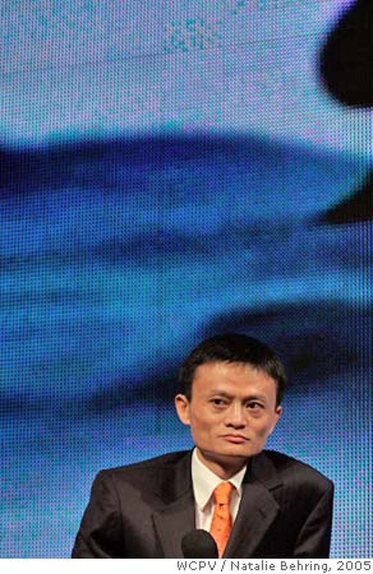 Jack Ma of Alibaba.com listens as former US president Clinton speaks during China Internet Summit in Hangzhou China