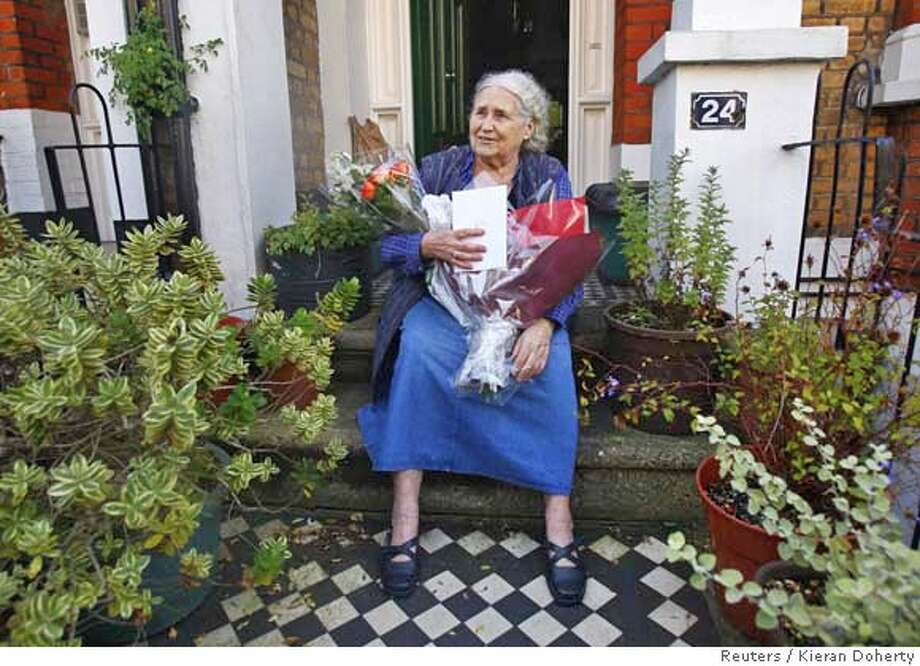 British novelist Doris Lessing smiles on the doorstep of her house in London October 11, 2007. Lessing won the 2007 Nobel Prize for literature on Thursday for a body of work that delved into human relations and inspired a generation of feminist writers. REUTERS/Kieran Doherty (BRITAIN) 0 Photo: KIERAN DOHERTY