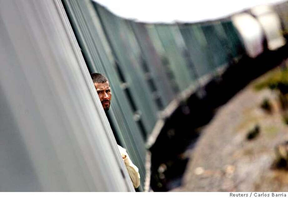 Luis Gomez of Honduras travels on a cargo train to border city of Nuevo Laredo Photo: CARLOS BARRIA