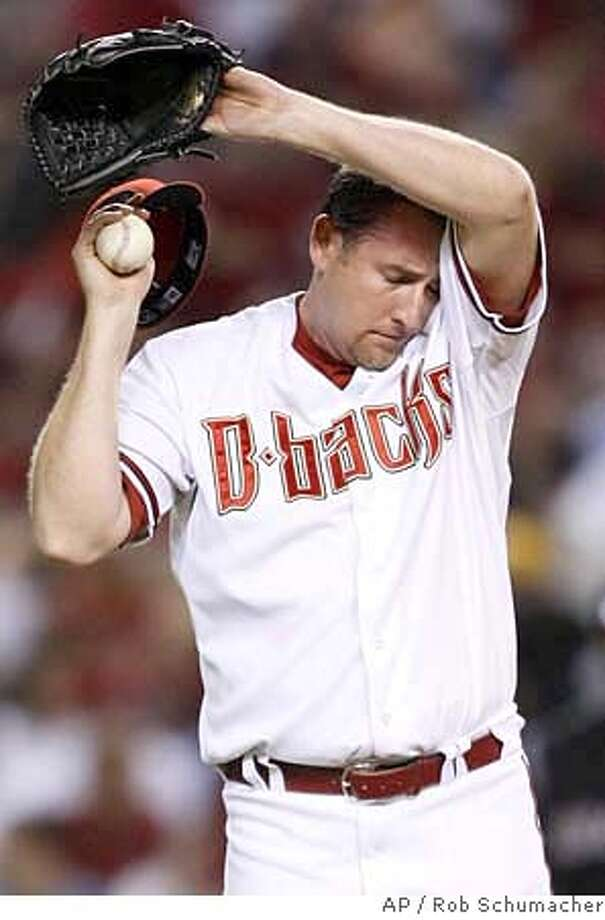 Diamondbacks starting pitcher Brandon Webb on the mound in the third inning of Game 1 of the National League Championship baseball series in Phoenix, Thursday, Oct. 11, 2007. (AP Photo/The Arizona Republic, Rob Schumacher) MAGS OUT NO SALES Photo: Rob Schumacher