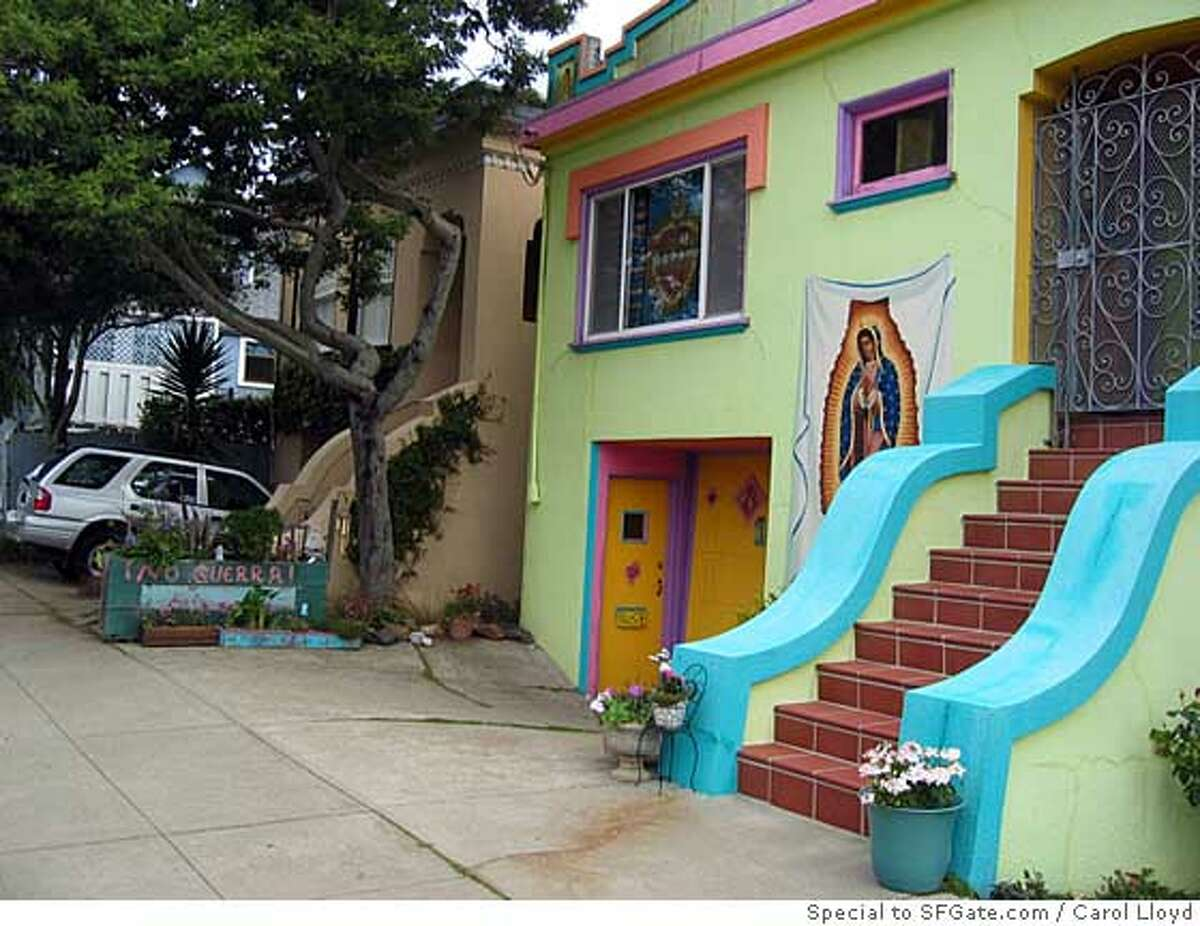 Toni Cunningham's home in the Sunnyside district of San Francisco displays the Virgin of Guadalupe and a long flower box bearing the words