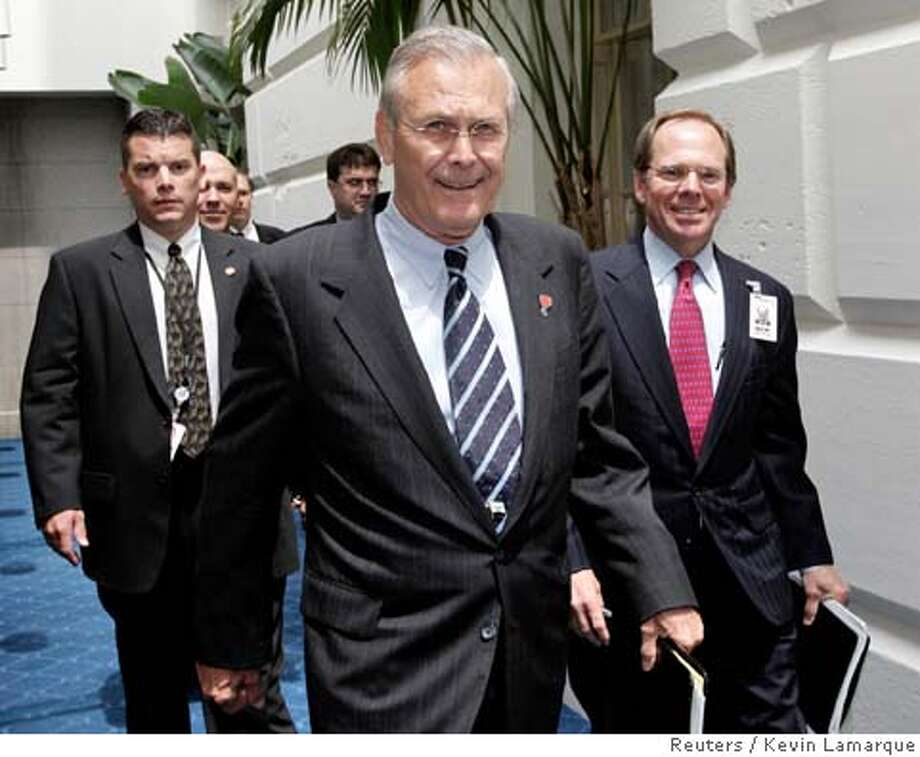US Secretary of Defense Rumsfeld arrives at the Capitol to brief members of Congress on Iraq Photo: KEVIN LAMARQUE