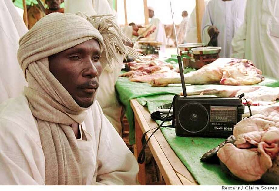 Adam Sherif, a Darfur refugee living at Gaga camp in eastern Chad, listens to Arabic radio to find out the latest developments at the Darfur peace talks May 5, 2006. After three deadlines for a deal passed, the biggest of three Darfur rebel factions and the Sudanese government signed a peace agreement on Friday but two other rebel factions rejected the deal, casting doubt on whether it would be workable.REUTERS/Claire Soares Photo: CLAIRE SOARES