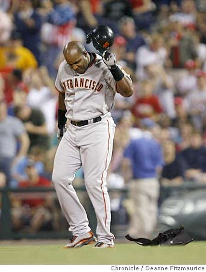 Barry Bonds throws down his batting helmet in frustration after grounding into a double play in the 5th inning. San Francisco Giants vs the Philadelphia Phillies at Citizens Bank Park.  This event was shot in Philadelphia on 5/5/06.  Chronicle Photo by Deanne Fitzmaurice Photo: Deanne Fitzmaurice