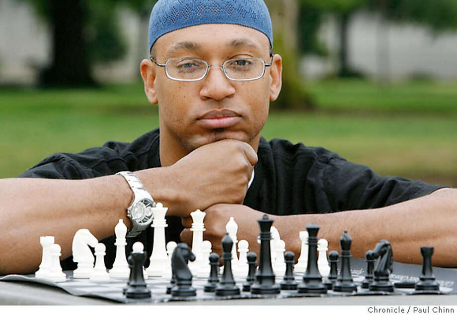 Adisa Banjoko, co-founder of the Hip Hop Chess Federation, played a game of chess at a neighborhood park in Fremont, Calif. on Saturday, May 26, 2007. PAUL CHINN/The Chronicle  **Adisa Banjoko Photo: PAUL CHINN