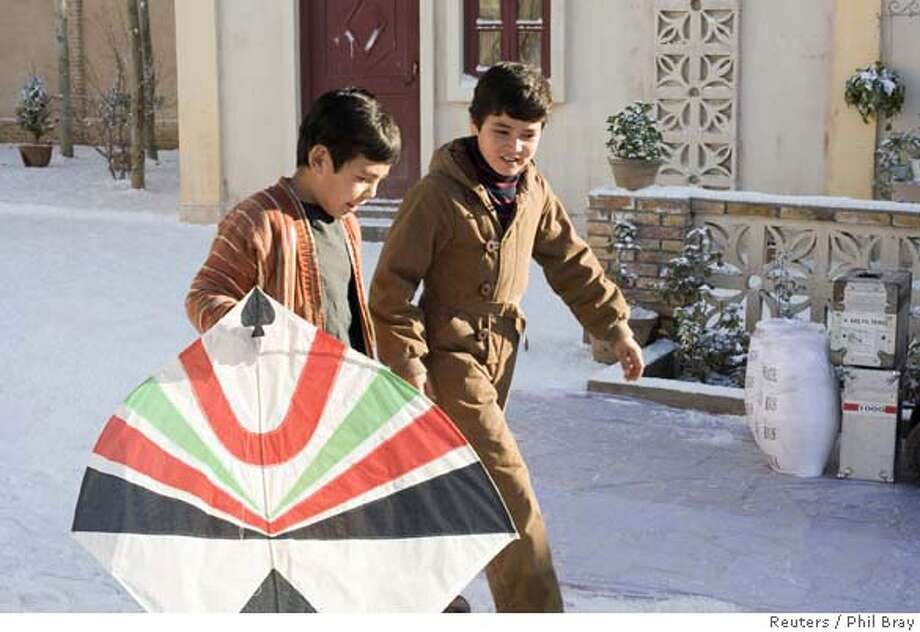 "Young actors Ahmad Khan Mahmoodzada as ""Hassan"" and Zekiria Ebrahimi as ""Amir"" are shown in this undated publicity photograph in a scene from director Marc Forster�s new film ""The Kite Runner"". The studio behind the film about civil strife in Afghanistan has arranged to get its three young stars out of their homeland before the film's release to protect them from a possible violent backlash. REUTERS/Phil Bray/DreamWorks LLC/Handout (UNITED STATES). EDITORIAL USE ONLY. NOT FOR SALE FOR MARKETING OR ADVERTISING CAMPAIGNS. NO ARCHIVES. NO SALES.  Ran on: 10-11-2007  Ahmad Khan Mahmidzada (left) and Zekeria Ebrahimi appear in the film &quo;The Kite Runner.&quo;  Ran on: 10-11-2007  Ahmad Khan Mahmidzada (left) and Zekeria Ebrahimi appear in the film &quo;The Kite Runner.&quo; Photo: HO"