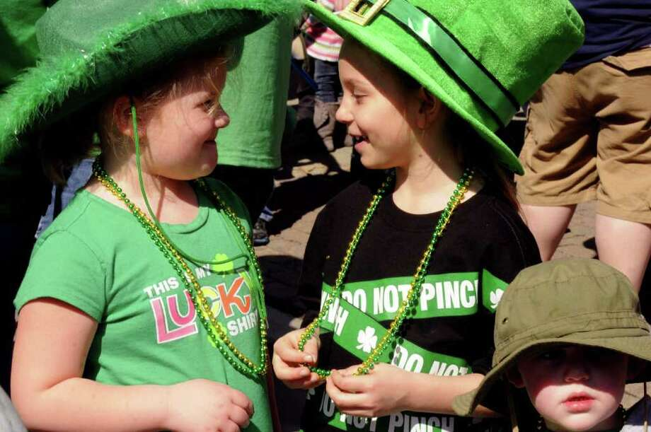 Cousins Savannah Sawyer,5-years-old,left,Tristen Taylor, 7-years-old, dressed in green talk during the 62nd Annual Albany St. Patrick?s Parade in Albany, NY Saturday March 17, 2012.( Michael P. Farrell/Times Union ) Photo: Michael P. Farrell