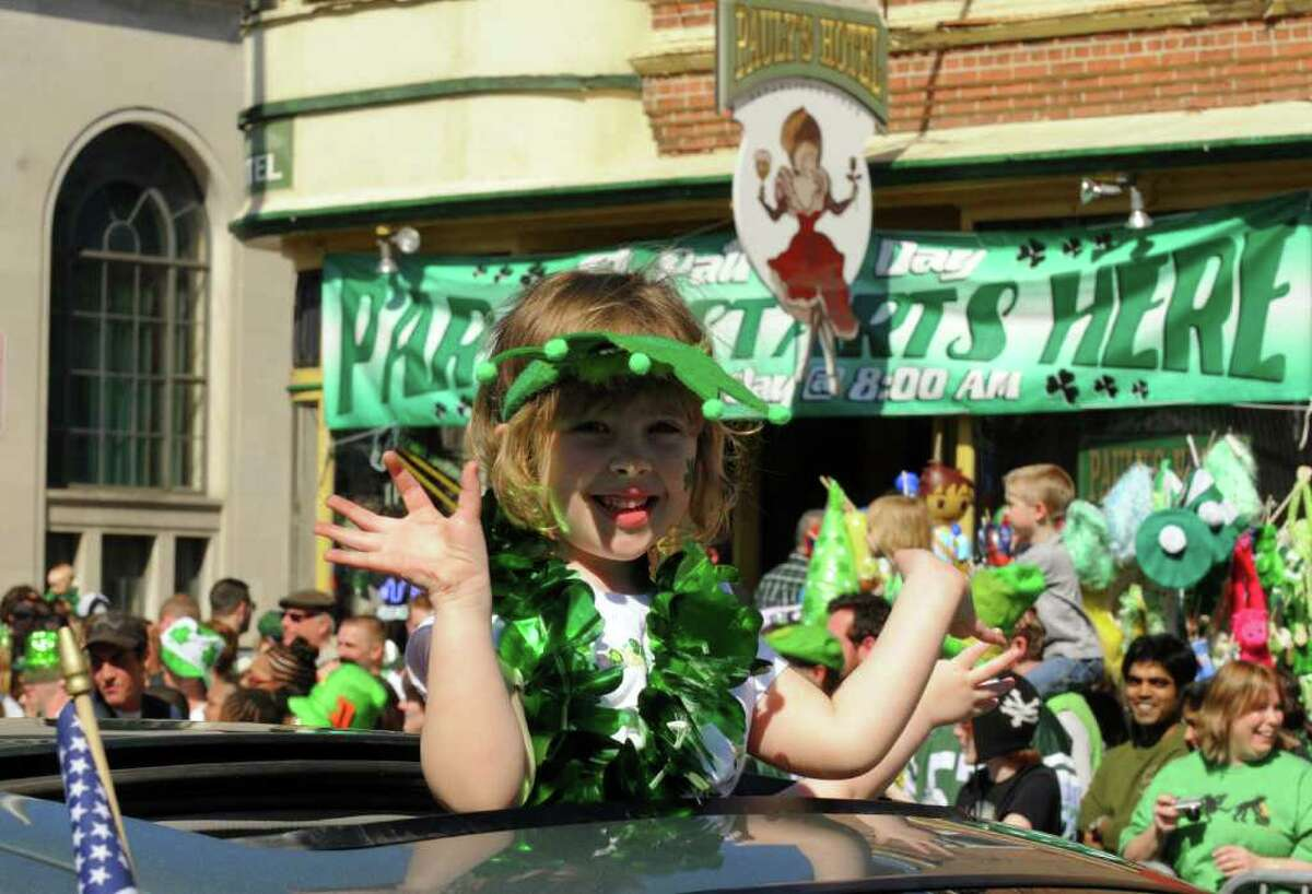 Five-year-old Olivia Schultheis of Watervliet rides in the 62nd Annual Albany St. Patrick?s Parade in Albany, NY Saturday March 17, 2012.( Michael P. Farrell/Times Union )