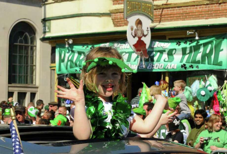 Five-year-old Olivia Schultheis of Watervliet rides in the 62nd Annual Albany St. Patrick?s Parade in Albany, NY Saturday March 17, 2012.( Michael P. Farrell/Times Union ) Photo: Michael P. Farrell