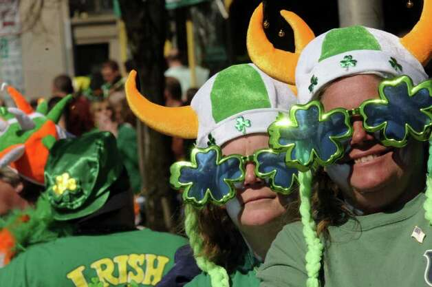 Sisters Cheryl Quenneville and Anna Didomenico,right, wear the green during the 62nd Annual Albany St. Patrick?s Parade in Albany, NY Saturday March 17, 2012.( Michael P. Farrell/Times Union ) Photo: Michael P. Farrell