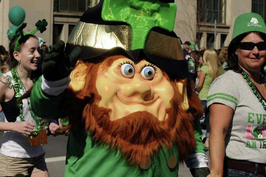 A leprechaun character marches in the 62nd Annual Albany St. Patrick?s Parade in Albany, NY Saturday March 17, 2012.( Michael P. Farrell/Times Union ) Photo: Michael P. Farrell