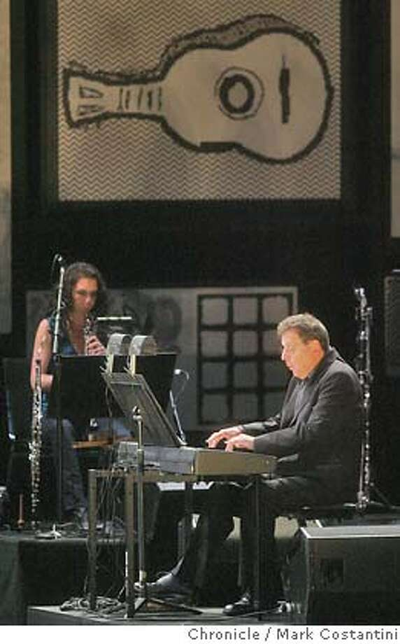 "Philip Glass (at piano) performing ""Book Of Longing,"" new Philip Glass piece with words by Leonard Cohen performed at Memorial Auditorium at Stanford University. .PHOTO: Mark Costantini / The Chronicle Photo: MARK COSTANTINI"