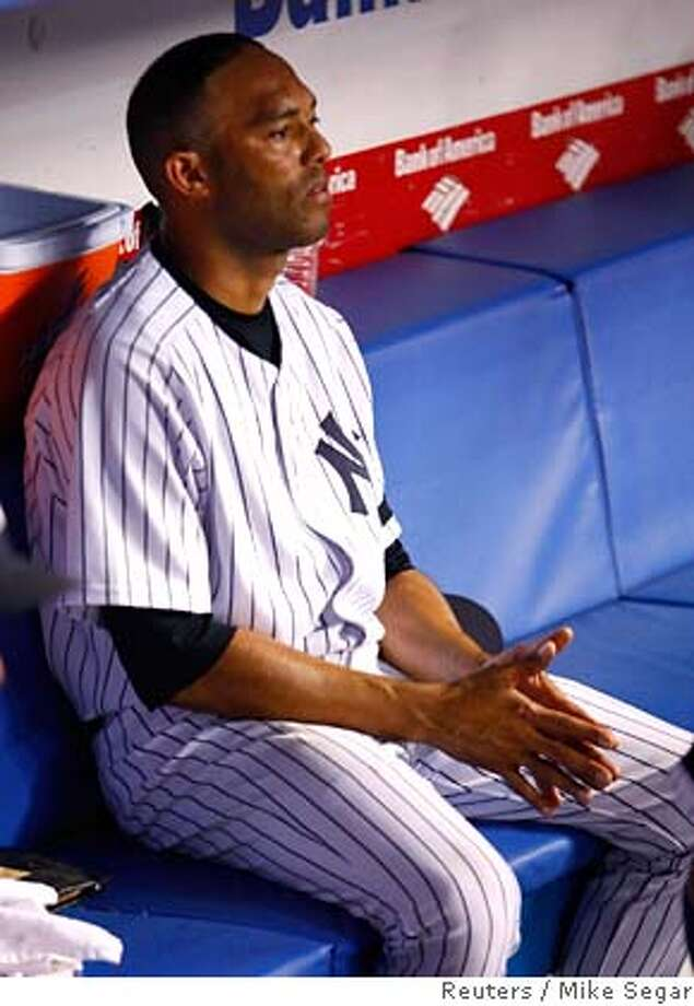 New York Yankees Mariano Rivera sits on the bench after the Cleveland Indians defeated them in their MLB American League Division Series playoff baseball series in New York, October 8, 2007. REUTERS/Mike Segar (UNITED STATES) 0 Photo: MIKE SEGAR