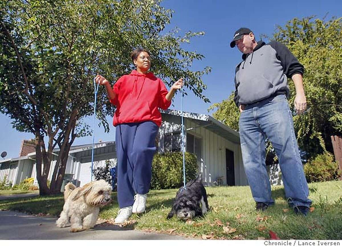 LOANMOD09_72923.JPG Susan and Paul and Howard of Sacramento walk their dogs Chipper and Chopper in front of their home. The Howard's are feeling pinched by rising interest on adjustable mortgages. Paul has been trying unsuccessfully to get Litton Loan to modify his ARM. It went up $550 a month in April/May and is slated to go up again in December and every six months thereafter. Howard is one of the lucky one; his loan company has pledged to work with him freezing his current loan for at least six months. OCTOBER 06, 2007. Lance Iversen/The Chronicle (cq) SUBJECT 10/06/07,in SACRAMENTO. CA.