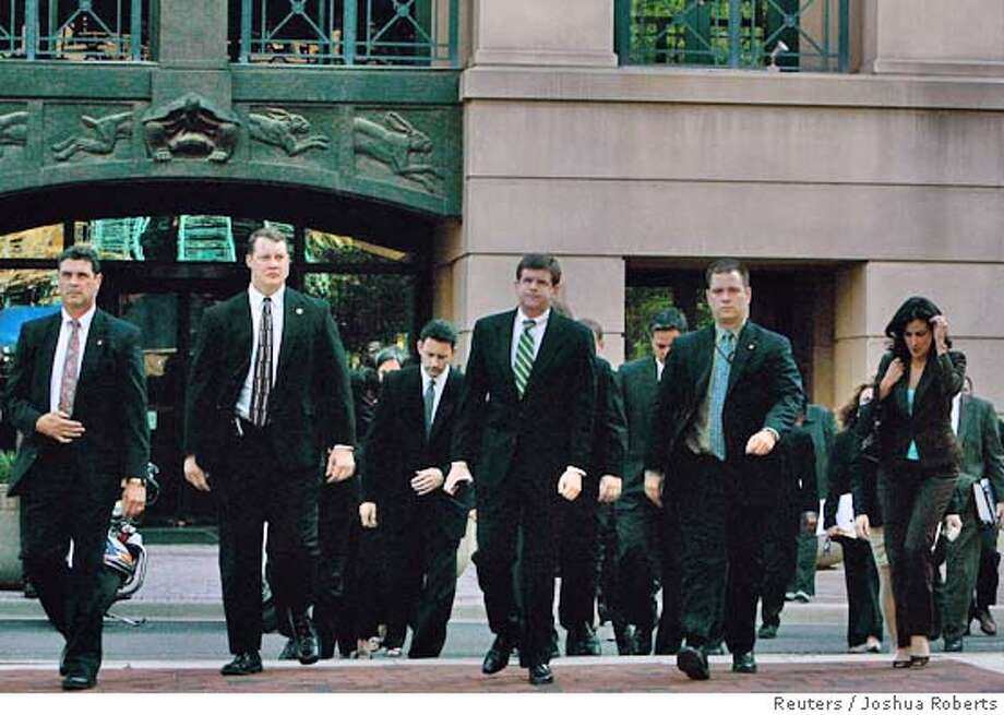 The prosecution team lead by Deputy Attorney General Paul J. McNulty (C) after the life imprisonment verdict was announced against Zacarias Moussaoui for contributing to the September 11, 2001 terrorist attacks in Alexandria, Virginia, May 3, 2006. September 11 conspirator Moussaoui should spend his life in prison instead of being executed for his role in the hijacked airliner attacks, a US jury decided on Wednesday. REUTERS/Joshua Roberts 0 Photo: JOSHUA ROBERTS