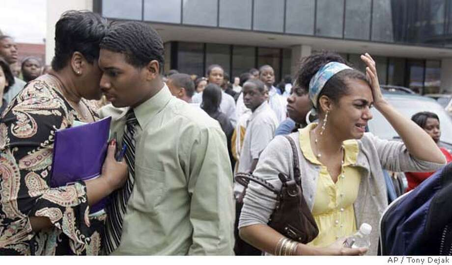 Students congregate outside the Success Tech Academy, Wednesday, Oct. 10, 2007, in Cleveland. A gunman opened fire in a downtown alternative high school Wednesday, and five people were taken to a hospital, the mayor said. (AP Photo/Tony Dejak) Photo: Tony Dejak