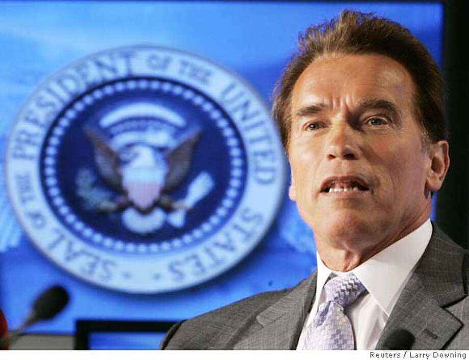 California Gov. Arnold Schwarzenegger participates in a panel discussion on the American competitiveness Initiative at the Cisco Systems, Inc. headquarters building in San Jose, California, April 21, 2006. Reuters / Larry Downing 0