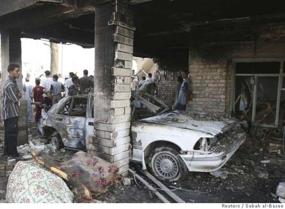 Residents gather at the site of a bomb attack in Baiji, 180 km (110 miles) north of Baghdad October 9, 2007. Two suicide car bombs killed at least 22 people in northern Iraq on Tuesday in attacks targeting a police chief and a Sunni Arab tribal leader, police said. Baiji is a major oil refining centre fed with crude oil and gas from the vast fields under the nearby city of Kirkuk. REUTERS/Sabah al-Bazee (IRAQ) 0 Photo: STRINGER/IRAQ