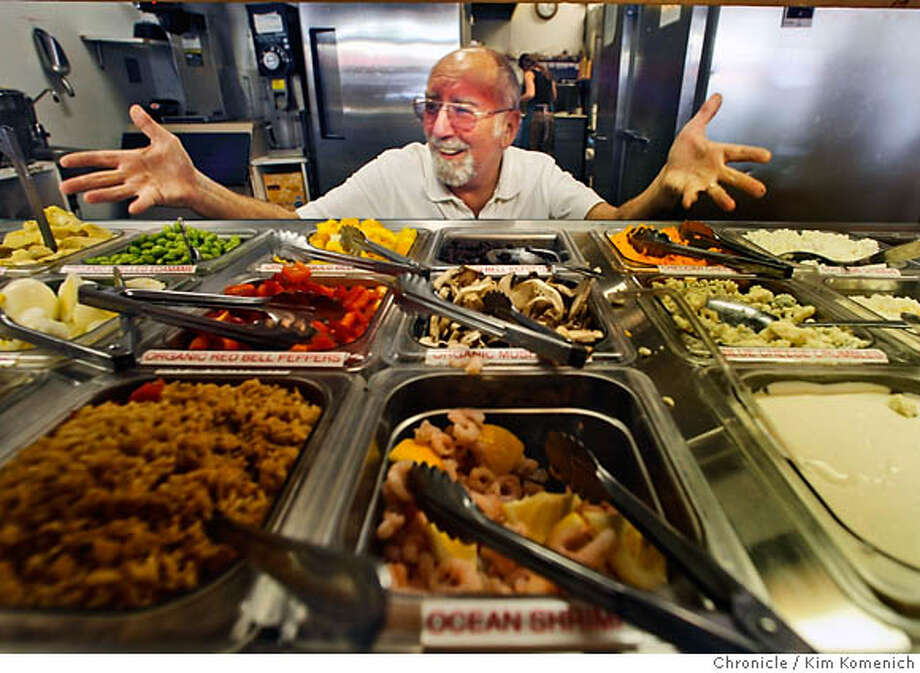 ORGANIC_GRILLA03_024_KK.JPG  Fred Marken looks at the salad bar at his downtown chico restaurant. He has started a new little chain of organic (mostly) fast food cafes that are a hit in Chico (two cafes) and Ashland and Medford, Oregon. We photograph Marken in his Chico cafes.  San Francisco Chronicle photo by Kim Komenich  4/19/06 �2006, Kim Komenich/The San Francisco Chronicle Photo: Kim Komenich