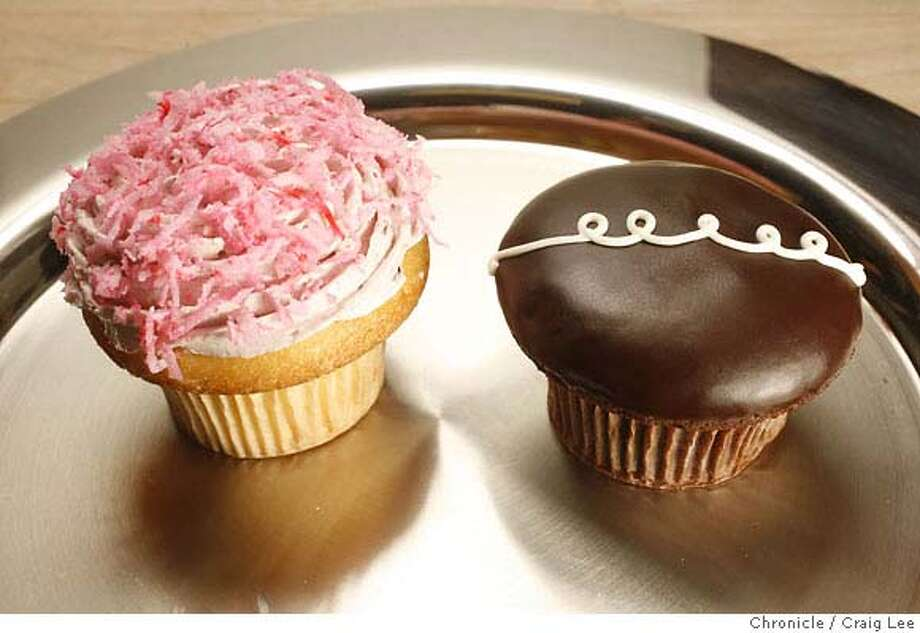 "WHATS10_dessert_034_cl.JPG  The Most-est Cupcake (chocolate with white squiggly line) and the Zinger'd cupcake (Pink colored) at the Noe Valley Bakery and Bread Company. These cupcakes are ""copies"" of the Hostess Cupcakes. on 10/8/07 in San Francisco. photo by Craig Lee / The Chronicle  Ran on: 10-10-2007 Photo: Photo By Craig Lee"