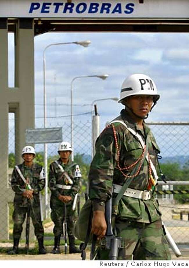Bolivian Army soldiers guard Petrobras oil refinery after President Morales decreed nationalization of industry Photo: STR