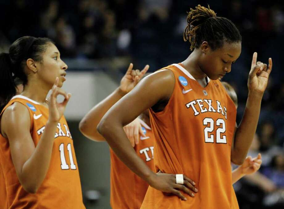 Texas guard Chelsea Bass (11) and  Ashley Gayle (22) put their horns up during the playing of their fight song after they lost 68-55 to West Virginia in a first-round NCAA tournament women's college basketball game in Norfolk, Va., Saturday, March 17, 2012.   (AP Photo/Steve Helber) Photo: Steve Helber, Associated Press / AP