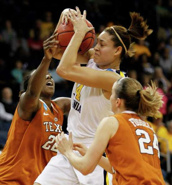 West Virginia forward Jess Harlee (14) tries to shoot a basket as Texas forward Ashley Gayle (22) an