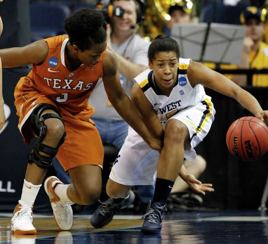 Texas forward Nneka Enemkpali (3) tries to get steal the ball from West Virginia forward Averee Fields (5) during the first half of a first-round NCAA tournament women's college basketball game in Norfolk, Va., Saturday, March 17, 2012.    (AP Photo/Steve Helber) Photo: Steve Helber, Associated Press / AP