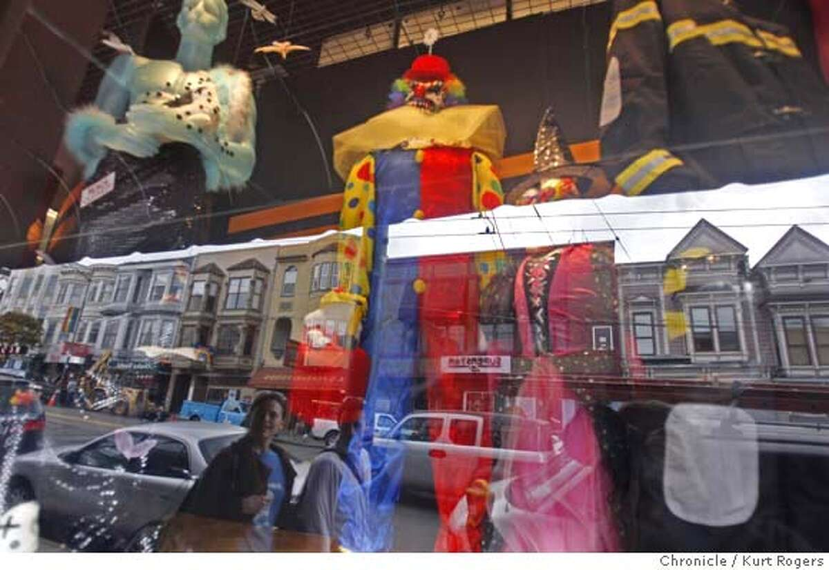 People walking on Castro street look in the window of Cliffs Variety in the Castro where they have set up an elaborate Halloween display. Halloween in he Castro has always been a large party and everyone thinks that this year will be the same. as a couple of Halloween costume stores have recently opened in the Castro area. HALLOWEEN10_0110_KR.jpg Kurt Rogers / The Chronicle Photo taken on 10/9/07, in San Francisco, CA, USA MANDATORY CREDIT FOR PHOTOG AND SAN FRANCISCO CHRONICLE/NO SALES-MAGS OUT