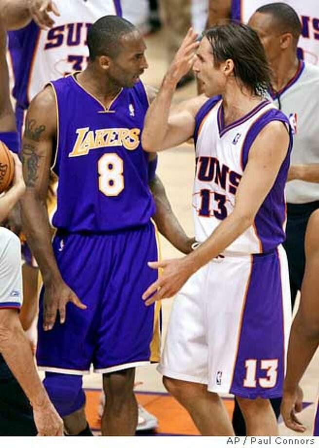 Los Angeles Lakers' Kobe Bryant (8) talks to Phoenix Suns guard Steve Nash (13) after Nash was fouled by Lakers' Sasha Vujacic during the first quarter of an NBA basketball first-round playoff game Wednesday, April 26, 2006, in Phoenix. (AP Photo/Paul Connors) Photo: PAUL CONNORS