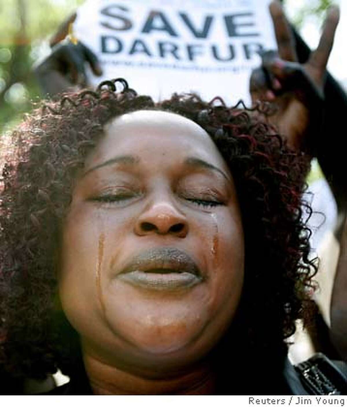 Tears stream down the face of a woman as she takes part in a rally calling for a stop to the genocide taking place in Darfur, in Washington