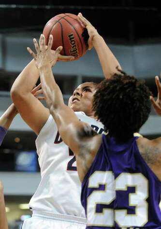 Connecticut's Kaleena Mosqueda-Lewis puts up the ball as Prairie View's Latia Williams guards her during the first-round NCAA game at the Webster Bank Arena in Bridgeport, Conn. Saturday, Mar. 17, 2012. Photo: Autumn Driscoll / Connecticut Post