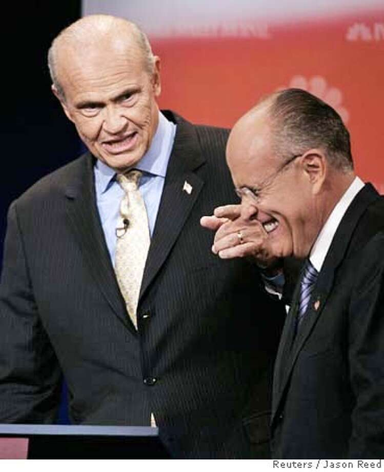 Republican presidential candidate former U.S. Senator Fred Thompson (R-TN) (L) makes a point as former New York City Mayor Rudy Giuliani laughs during the Republican presidential debate in Dearborn, Michigan, October 9, 2007. REUTERS/Jason Reed (UNITED STATES) Photo: JASON REED
