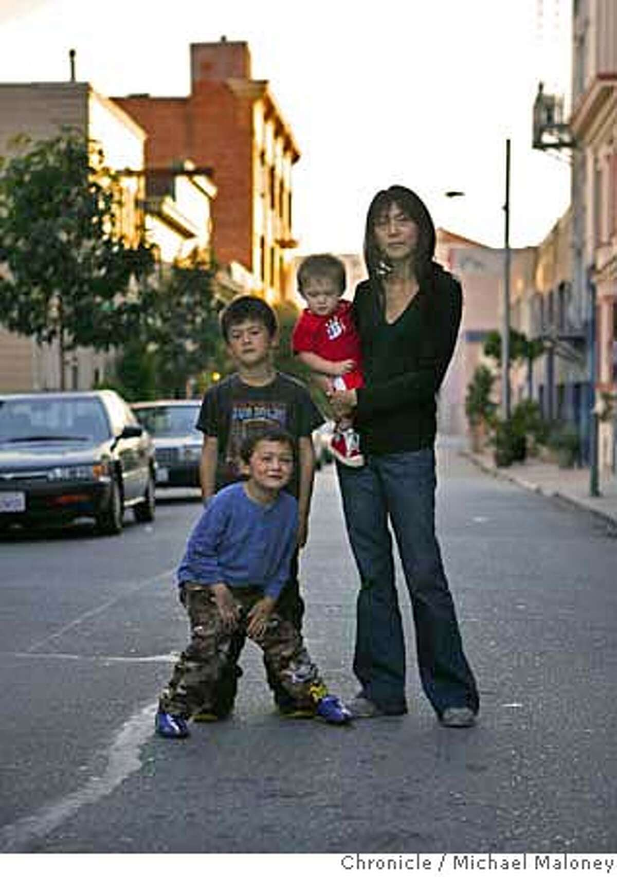 Jenny Kiely and her three boys pose outside their apartment building on Natoma Street. Jenny Kiely and her three boys Dylan (7), Nick (4) and Thomas (1) live with her husband David south of Market Street in San Francisco. The Kiely's have owned the home there for 18 years and love the neighborhood but they've had it with the vagrants and homeless in the neighborhood. Photo by Michael Maloney / San Francisco Chronicle ***Jenny Kiely, Dylan, Nick , Thomas MANDATORY CREDIT FOR PHOTOG AND SF CHRONICLE/NO SALES-MAGS OUT