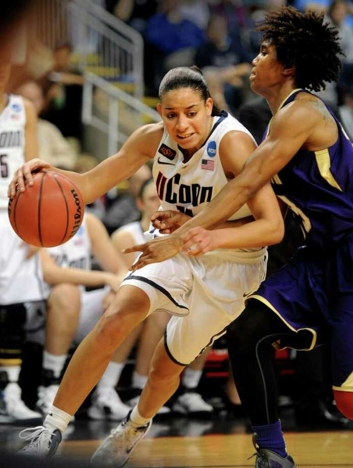 Connecticut's Bria Hartley drives to the net as Prairie View's Latia Williams defends during the first-round NCAA game at the Webster Bank Arena in Bridgeport, Conn. Saturday, Mar. 17, 2012. Photo: Autumn Driscoll / Connecticut Post
