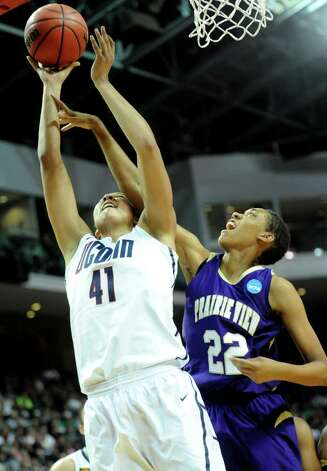 Connecticut's Kiah Stokes is fouled by Prairie View's Larissa Scott during the first-round NCAA game at the Webster Bank Arena in Bridgeport, Conn. Saturday, Mar. 17, 2012. Photo: Autumn Driscoll / Connecticut Post