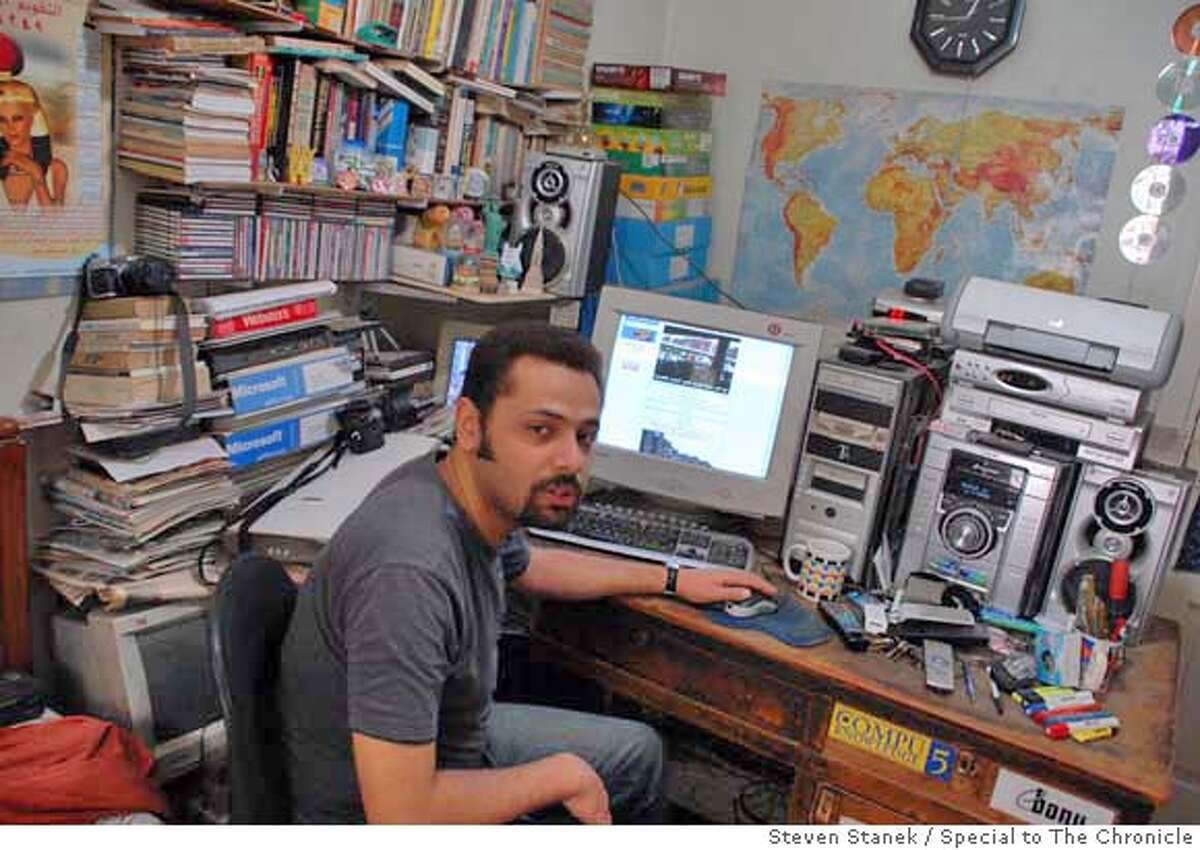 Wael Abbas, one of Egypt�s most popular and active bloggers, has posted several videos of police torture. He works out of his bedroom in his family�s flat in Cairo. Steven Stanek / Special to The Chronicle MANDATORY CREDIT FOR PHOTOG AND SAN FRANCISCO CHRONICLE/NO SALES-MAGS OUT