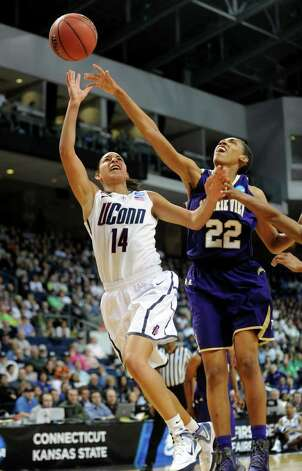 Connecticut's Bria Hartley attempts a shot as Prairie View's Larissa Scott defends during the first-round NCAA game at the Webster Bank Arena in Bridgeport, Conn. Saturday, Mar. 17, 2012. Photo: Autumn Driscoll / Connecticut Post