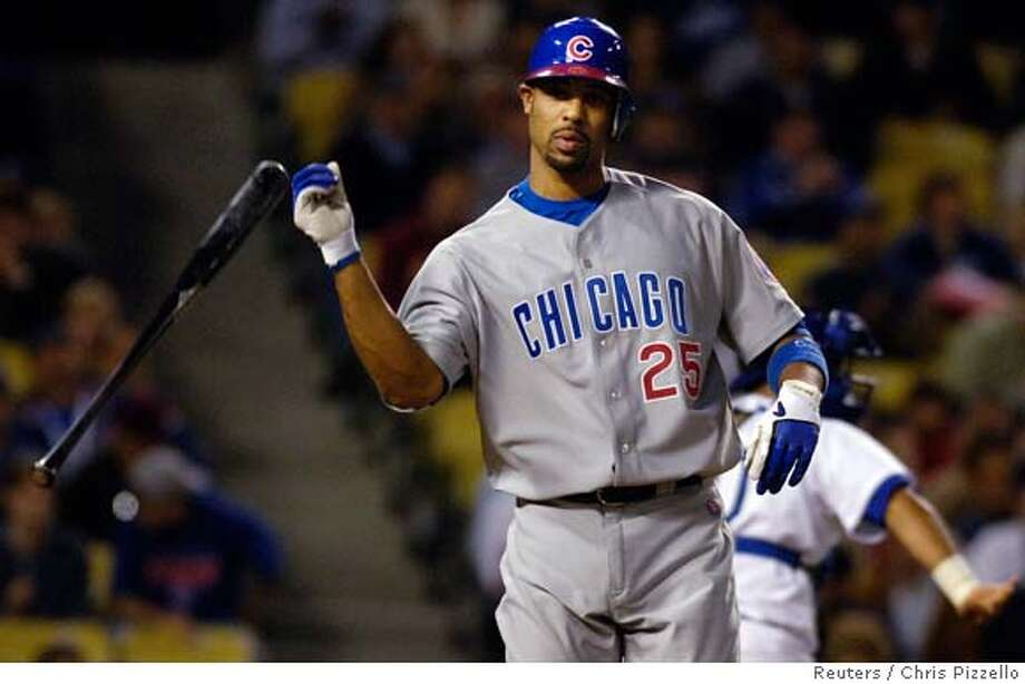 Chicago Cubs' Derrek Lee flips his bat after striking out with two men on base in Los Angeles Photo: CHRIS PIZZELLO