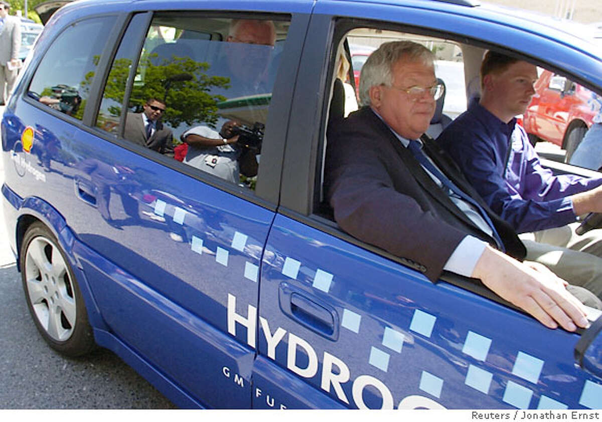 U.S. House Speaker Dennis Hastert (R-IL) rides away in a hydrogen-powered car after a news conference on gas prices at a gas station in Washington, April 27, 2006. Hastert appeared at the Capitol Hill gas station with several of his colleagues to show their support for developing alternative energy sources. REUTERS/Jonathan Ernst