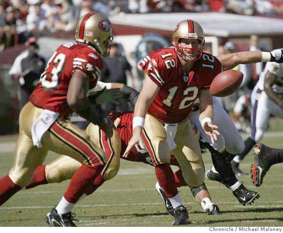 San Francisco 49ers quarterback Trent Dilfer (12) tosses the ball back to San Francisco 49ers Maurice Hicks (43) in the 1st quarter.  The San Francisco 49ers host the Baltimore Ravens in a NFL game at Monster Park in San Francisco, CA on 9/30/07. Photo by Michael Maloney / San Francisco Chronicle  ***code replacement from roster MANDATORY CREDIT FOR PHOTOG AND SF CHRONICLE/NO SALES-MAGS OUT Photo: Michael Maloney