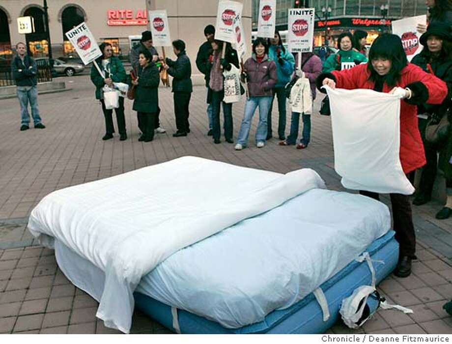 mattress18_075_df.JPG  Melody Li, a housekeeper at the Oakland Marriott for 15 years, makes a bed on the corner of 14th and Broadway in Oakland. Housekeepers are protesting that the new heavier, loftier mattresses are hurting their backs when they make the beds.  Event in Oakland on 12/16/05.  Deanne Fitzmaurice / The Chronicle Ran on: 12-19-2005  Melody Li, a housekeeper at the Oakland Marriott, makes a bed during a protest at the corner of 14th Street and Broadway in Oakland. Ran on: 12-19-2005  Melody Li, a housekeeper at the Oakland Marriott, makes a bed during a protest at the corner of 14th Street and Broadway in Oakland. Photo: Deanne Fitzmaurice