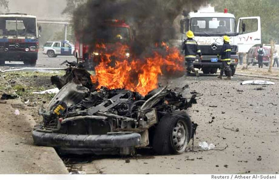 Vehicle burns after car bomb attack in Baghdad Photo: STRINGER/IRAQ
