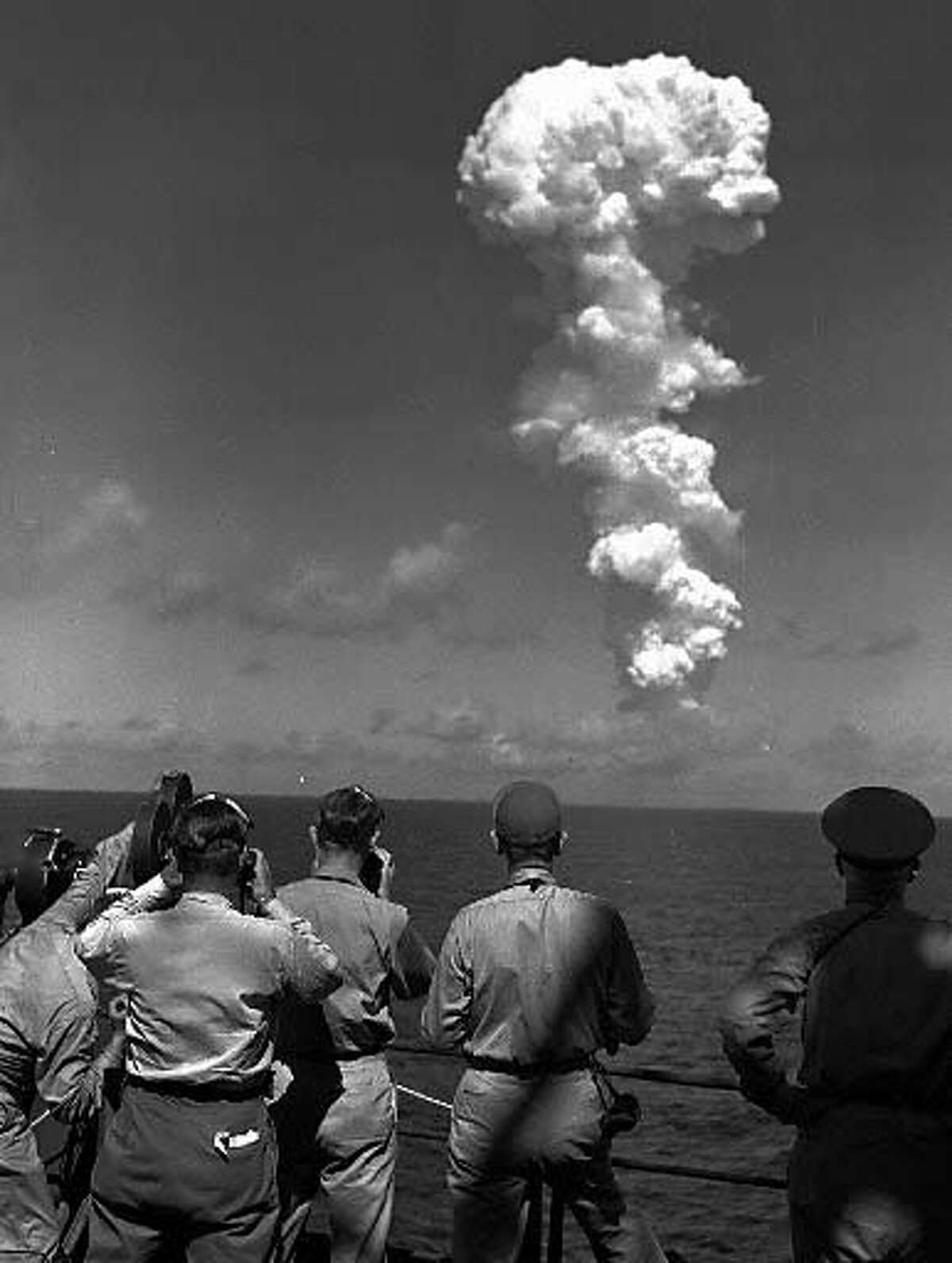 Observers aboard the Navy command ship Mount McKinley watch the mushroom cloud from the atomic bomb test on Bikini Atoll in the Marshall Islands on July 1, 1946. Associated Press photo, 1946, by Jack Rice