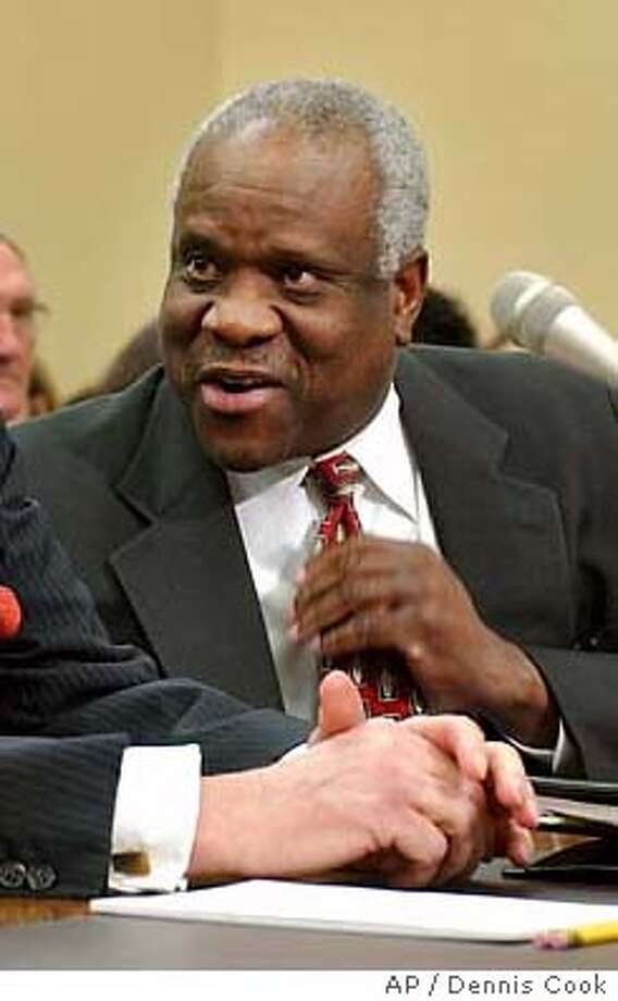 ANTHONY KENNEDY, CLARENCE THOMAS Photo: DENNIS COOK