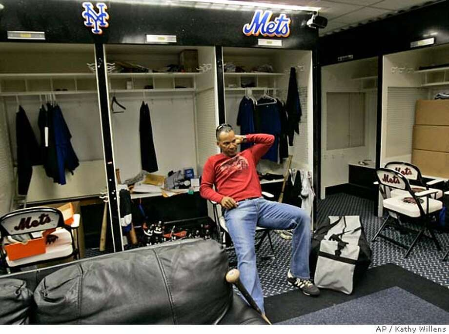 New York Mets' Moises Alou takes a break from packing his belongings in the Mets locker room at Shea Stadium in New York Monday, Oct. 1, 2007, one day after the Mets season ended in an 8-1 loss to the Florida Marlins. (AP Photo/Kathy Willens) Photo: Kathy Willens